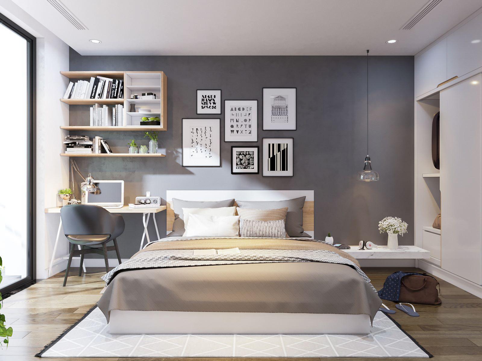 Hình ảnh bức tường đầu giường được trang trí bằng bộ tranh đen - trắng, cạnh đó là góc làm việc nhỏ gọn