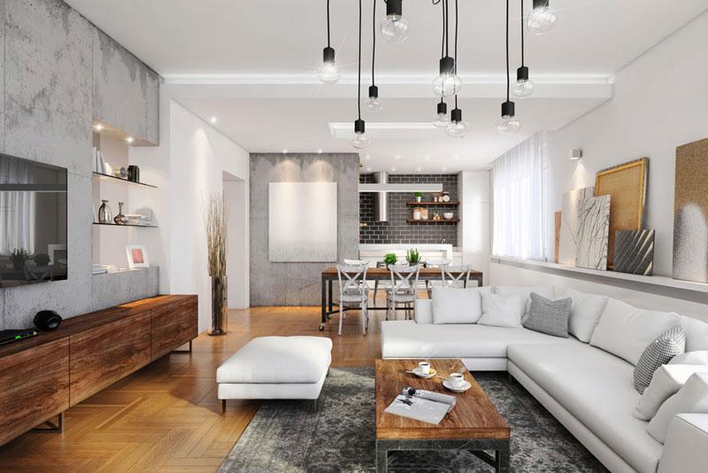 Hình ảnh phòng khách hiện đại với sofa trắng, bàn trà bằng gỗ đặt trên thảm lông xám, đối diện là kệ tivi,d dèn thả trang trí ánh sáng trắng bắt mắt