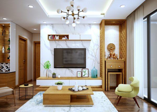 Hình ảnh toàn cảnh phòng khách kết hợp phòng thờ với bàn trà gỗ đặt trung tâm, đối diện là kệ tivi, cạnh đó là góc thờ cúng