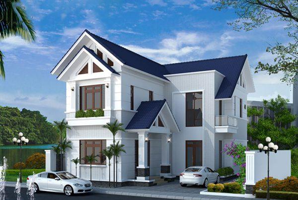 Hình ảnh phối cảnh mẫu nhà 2 tầng hình chữ L nổi bật với mái ngói màu xanh than, tường sơn trắng, hông nhà để ô tô, xung quanh có nhiều cây xanh