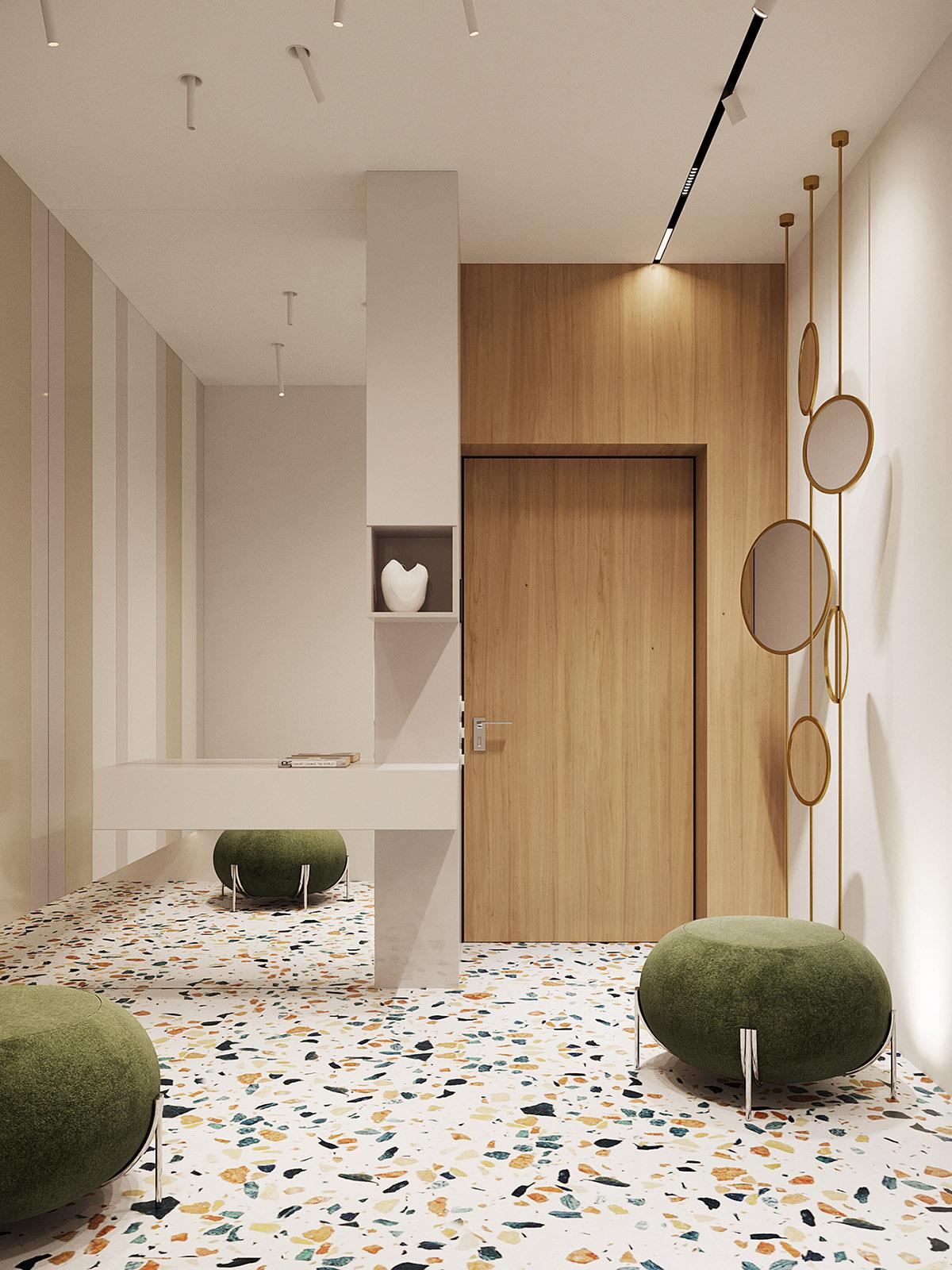 Hình ảnh lối vào căn hộ cực ấn tượng với gương thả hình tròn, ghế ngồi màu xanh rêu