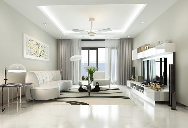 Hình ảnh phòng khách nhà phố sử dụng gạch lát và sơn tường màu trắng sáng, tranh treo tường họa tiết màu sắc nổi bật.
