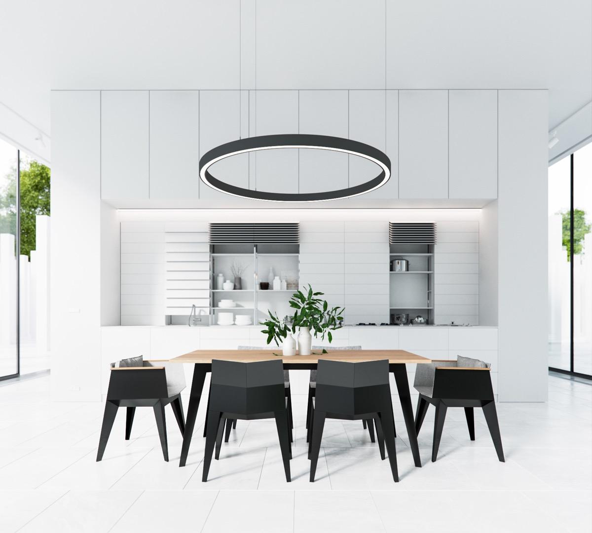 Hình ảnh phòng ăn màu đen trắng nổi bật với đèn chùm hình tròn lớn, ghế ăn hình học