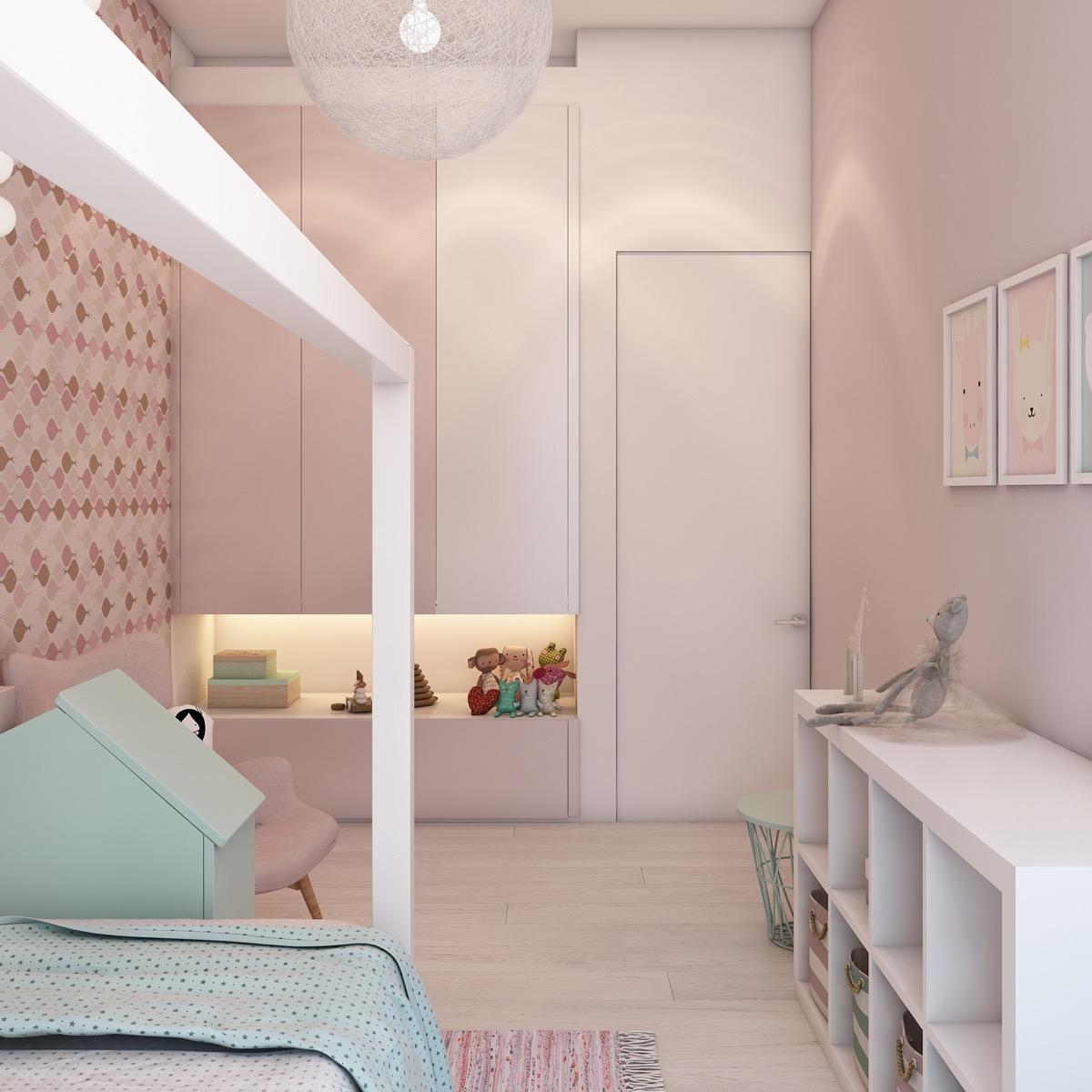 Hình ảnh một góc phòng ngủ với tủ kệ, tường màu hồng phấn, điểm nhấn là sắc xanh bạc hà nhẹ nhàng.
