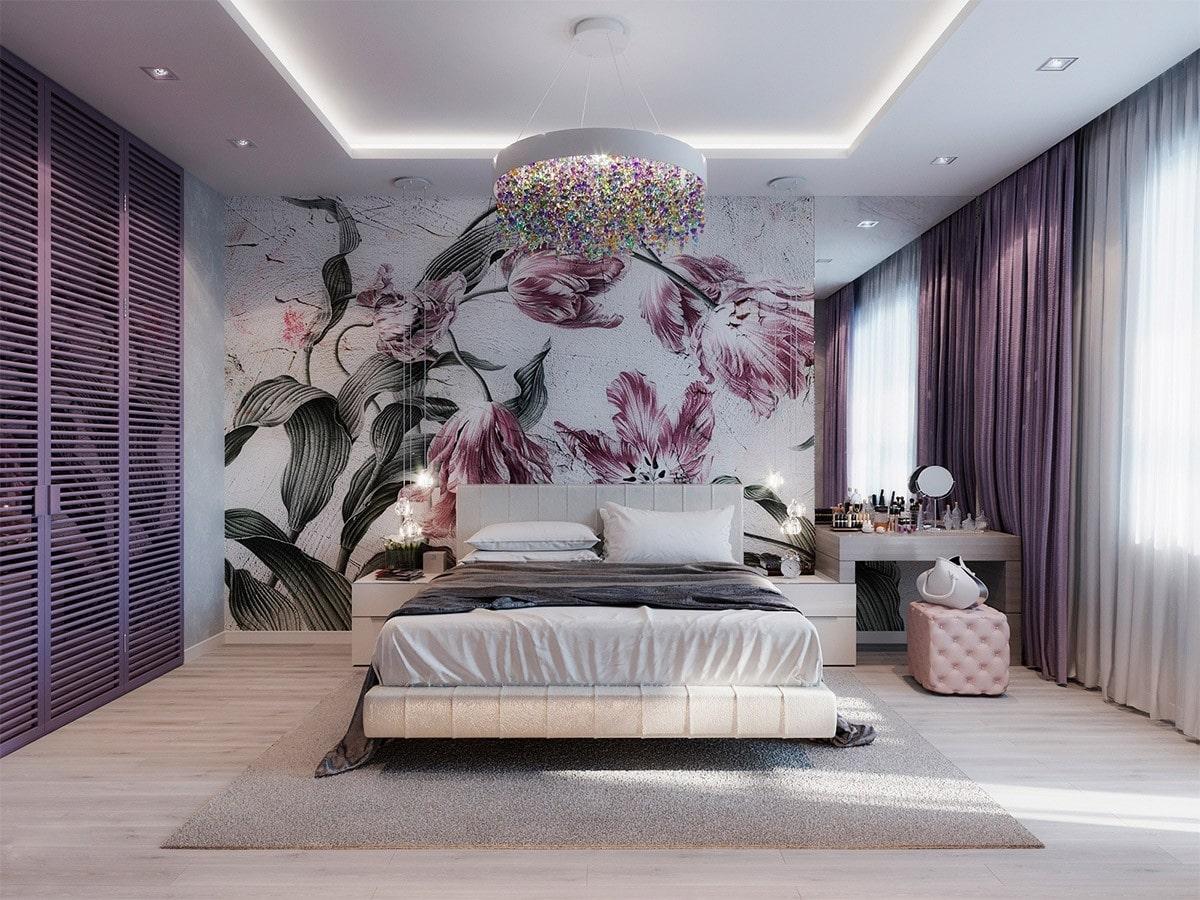 Hình ảnh toàn cảnh phòng ngủ tông màu tím oải hương lãng mạn, đầu giường trang trí tranh hoa tím lớn, phòng thay đồ nằm sau cửa chớp màu tím.