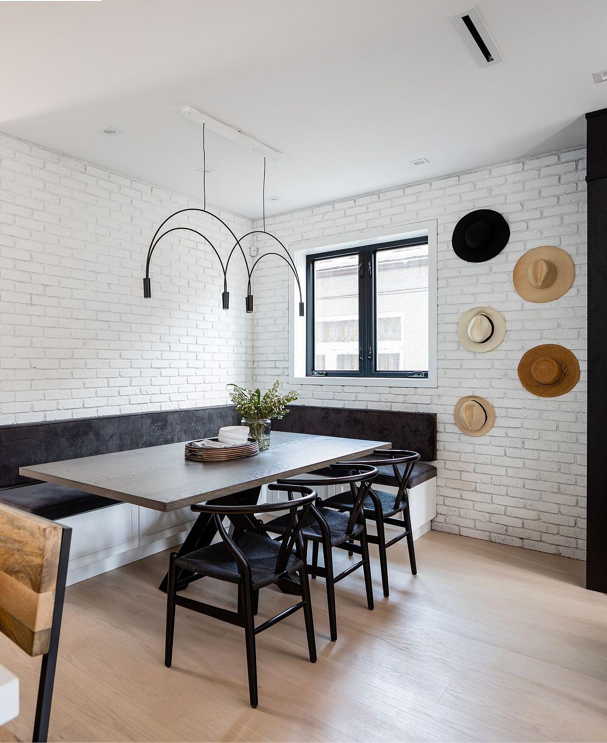Hình ảnh phòng ăn tối giản với tường gạch sơn trắng, bàn ghế kiểu dáng bắt mắt, đèn thả trần độc đáo