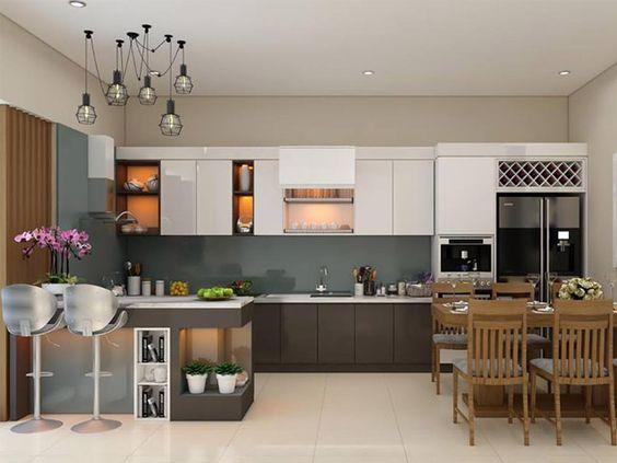 hình ảnh mẫu phòng bếp kết hợp phòng ăn đầy đủ tiện nghi với bàn ăn 4 ghế bằng gỗ, đèn thả trần, bar mini