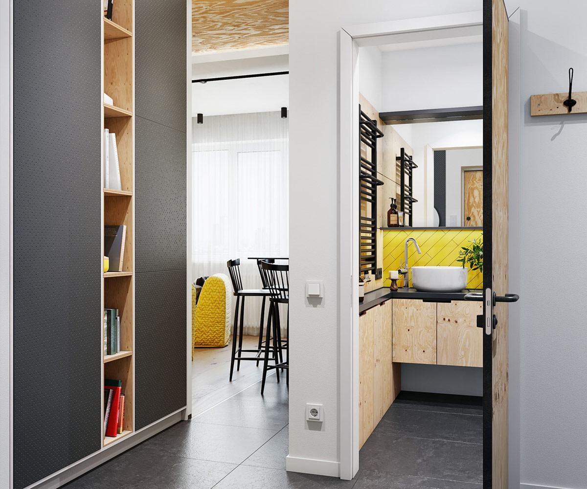 hình ảnh không gian bên trong căn hộ nhỏ đẹp với tủ kệ cao kịch trần, tường bếp ốp gạch vàng