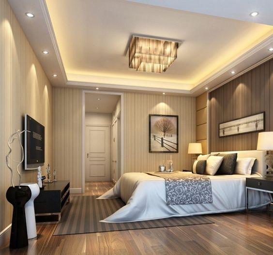 hình ảnh phòng ngủ master với ga gối êm ái, tranh treo đầu giường, tivi treo tường, lối vào bố trí tủ quần áo âm tường