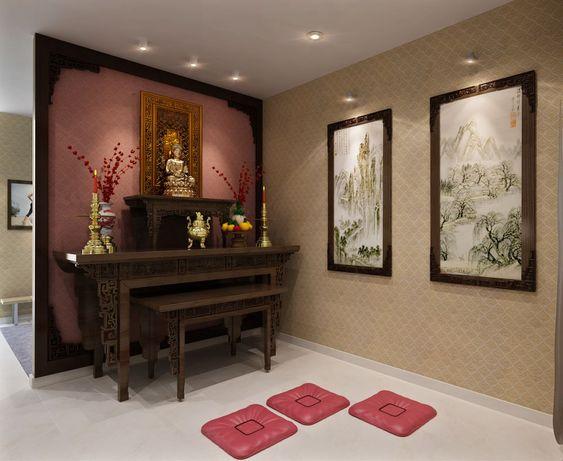 hình ảnh phòng thờ trong nhà ống 3 tầng với bàn ghế gỗ chạm khắc tinh xảo, đệm ngồi màu hồng