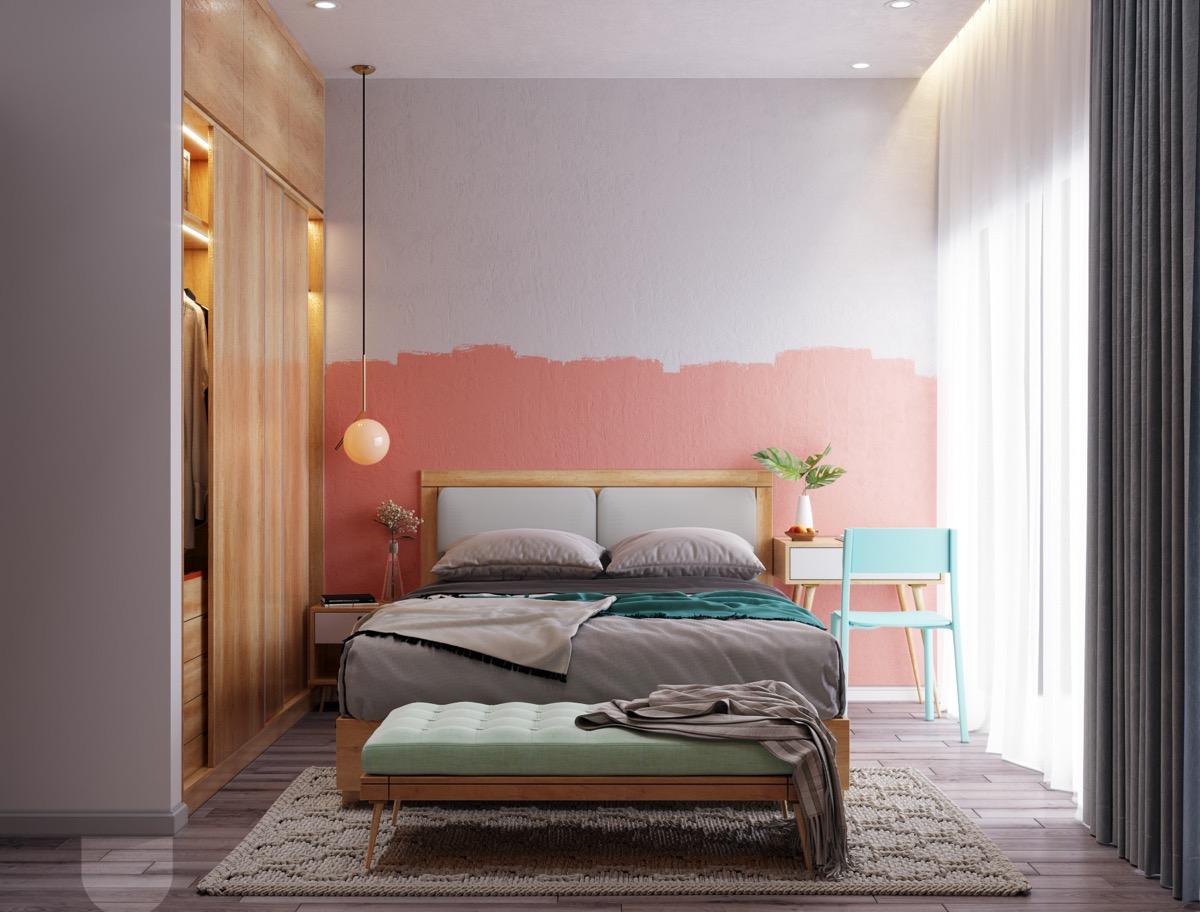 hình ảnh phòng ngủ ấn tượng với bức tường màu hồng điểm nhấn đầu giường, tủ quần áo âm tường