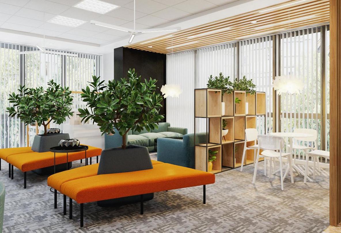 hình ảnh góc văn phòng độc đáo với chậu cây lớn nằm kẹp giữa hai bằng ghế màu cam, cạnh đó là bộ bàn ghế ăn màu trắng, vách trang trí bằng gỗ