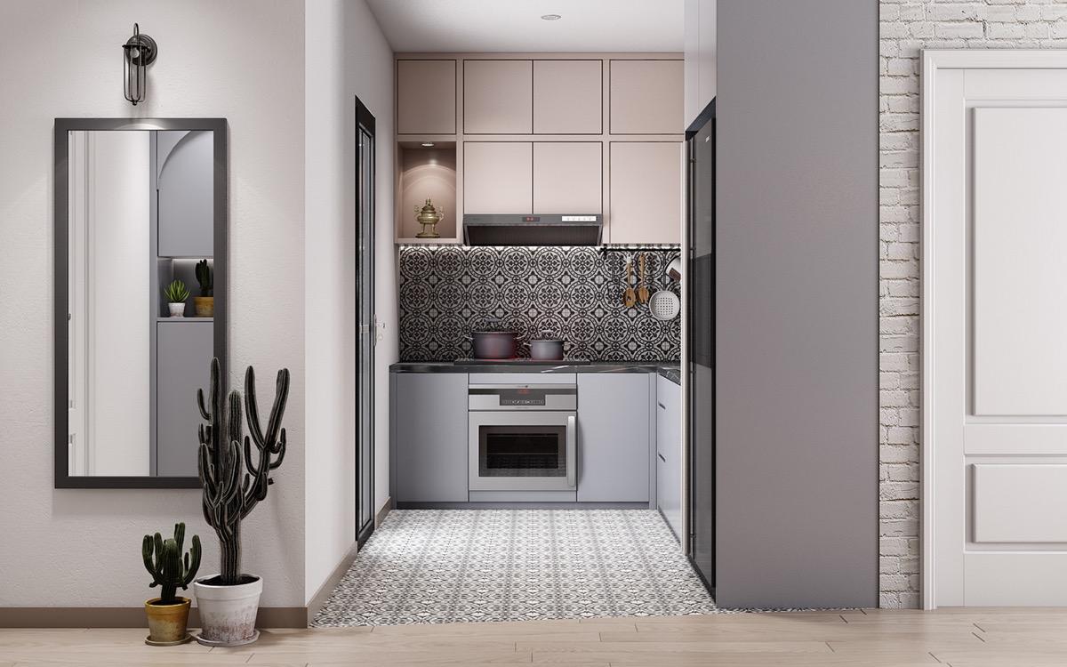Tủ lưu trữ mà ghi xám kết hợp ăn ý với gạch ốp lát hoa văn đen trắng mang đến vẻ đẹp hiện đại, tinh tế cho phòng bếp nhỏ.