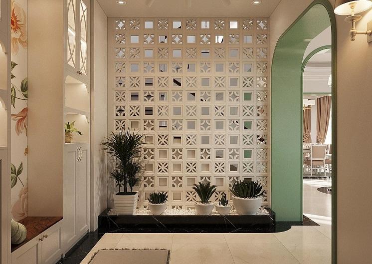 Tủ giày và trang trí cao kịch trần tại biệt thự Mimosa EcoPark. Khung cửa vòm cao thoáng, mềm mại dẫn lối vào không gian sinh hoạt bên trong.
