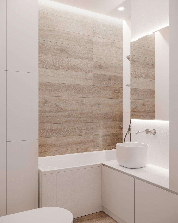 Mỗi cm2 trong phòng tắm nhỏ được tận dụng tối đa để bố trí hệ tủ kệ lưu trữ.