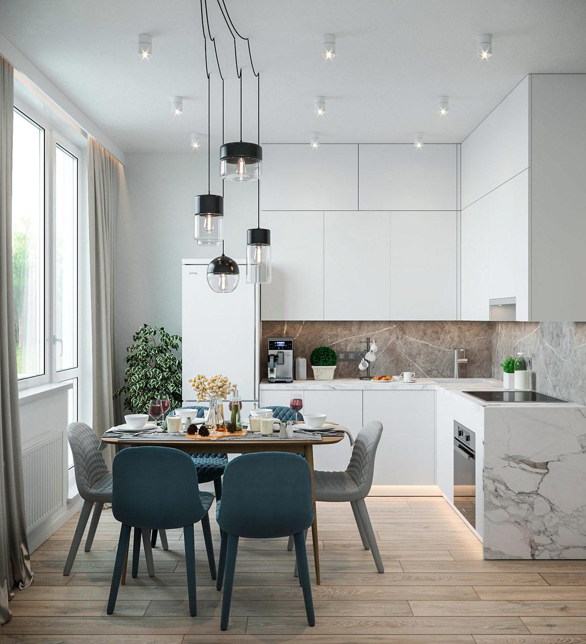 Phòng bếp hình chữ L bao quanh bộ bàn ăn 6 chỗ ngồi nhỏ gọn.