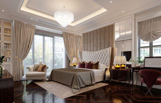 Nội thất phòng ngủ master rộng rãi, được thiết kế và bài trí theo phong cách sang trọng. Gối tựa, ghế ngồi trang điểm màu tím tạo điểm nhấn trên nền màu trung tính chủ đạo.