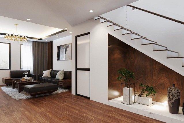 một góc phòng khách với lối cầu thang lên tầng trên shophouse