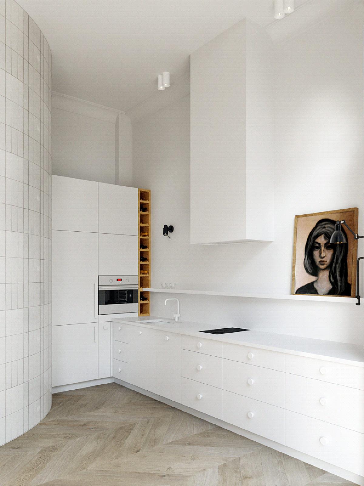 Kệ rượu vang và tranh tường nghệ thuật xua tan vẻ đơn điệu của phông nền màu trắng.