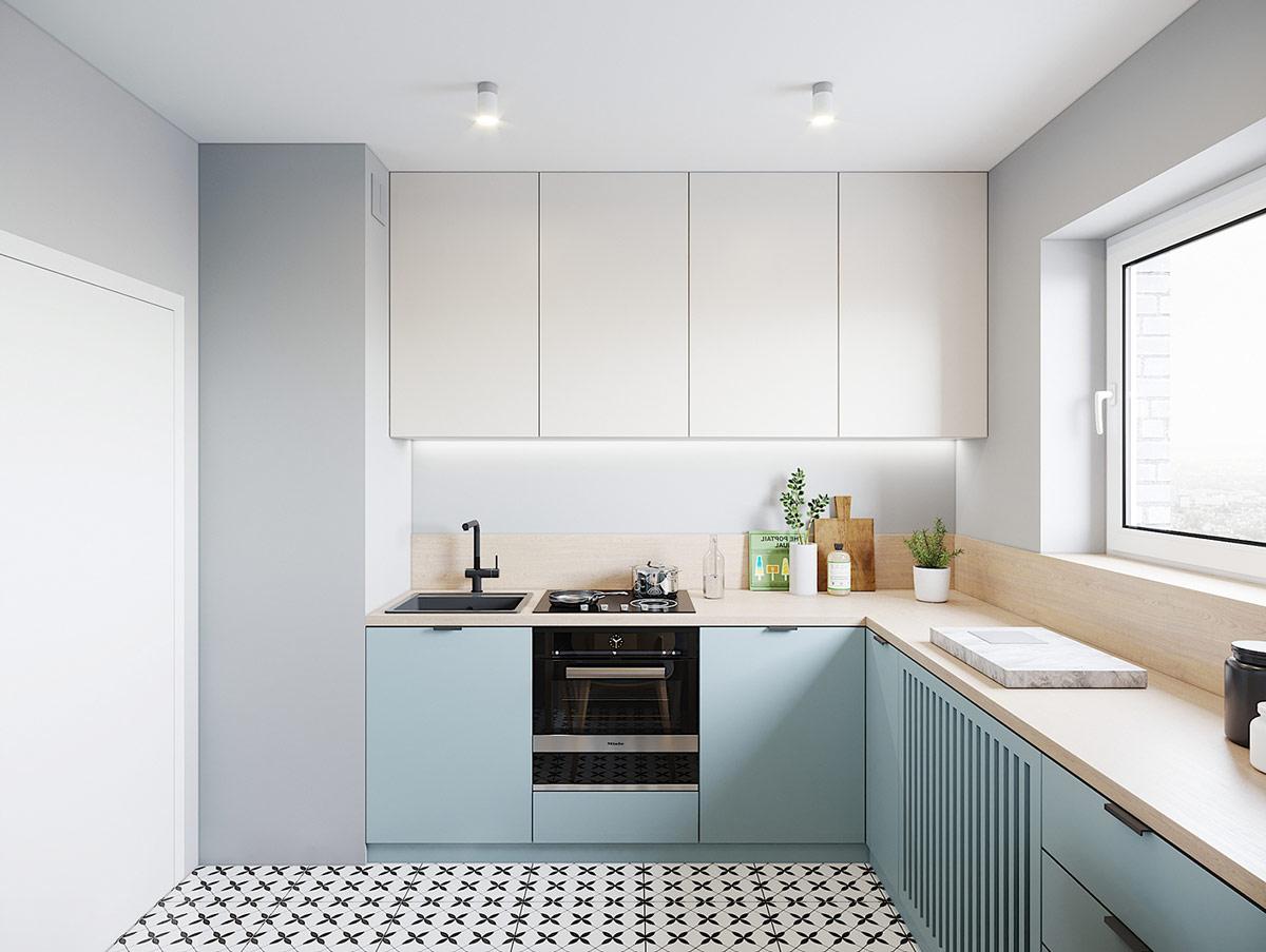 Mặt bàn bếp ốp gỗ tự nhiên thân thiện, an toàn. Cửa sổ kính mang đến ánh sáng tự nhiên ngập tràn không gian nấu nướng trong căn hộ 43m2.