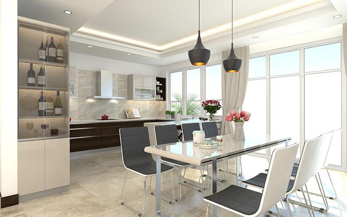hình ảnh phòng bếp với tường và hệ tủ tông màu trắng xám chủ đạo, cạnh đó là tủ rượu với cửa kính đẩy trong suốt