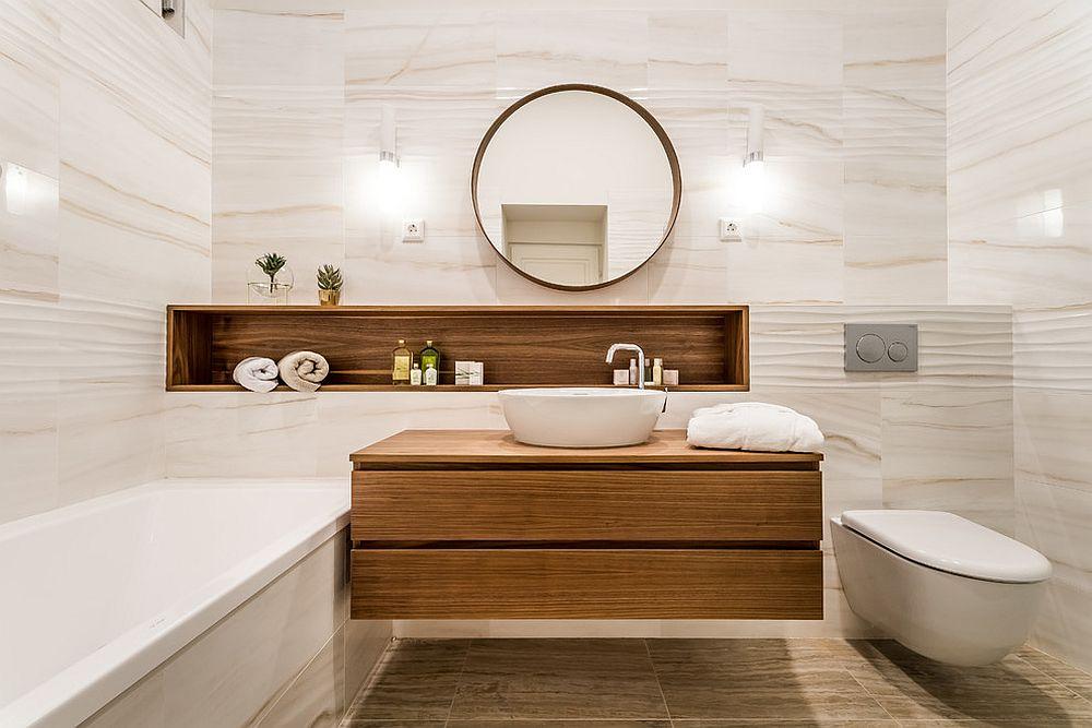 Tủ nổi dưới bồn rửa với chất liệu gỗ màu sáng trở thành tâm điểm của phòng tắm.