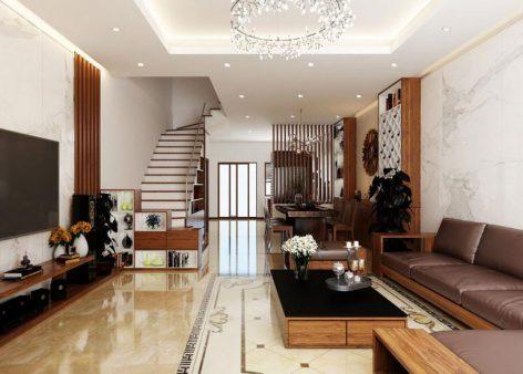 Hình ảnh phòng khách với sofa da màu nâu bò, tủ kệ tivi bằng gỗ, cầu thang lên tầng trên, phía trong là phòng ăn, bếp