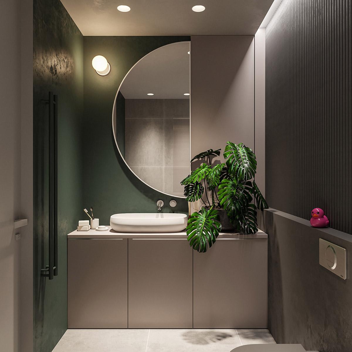 Sơn tường màu xanh lá cây xung quanh khu vực bồn rửa mặt được lấy cảm hứng từ vẻ đẹp tự nhiên của những chiếc lá gần đó.