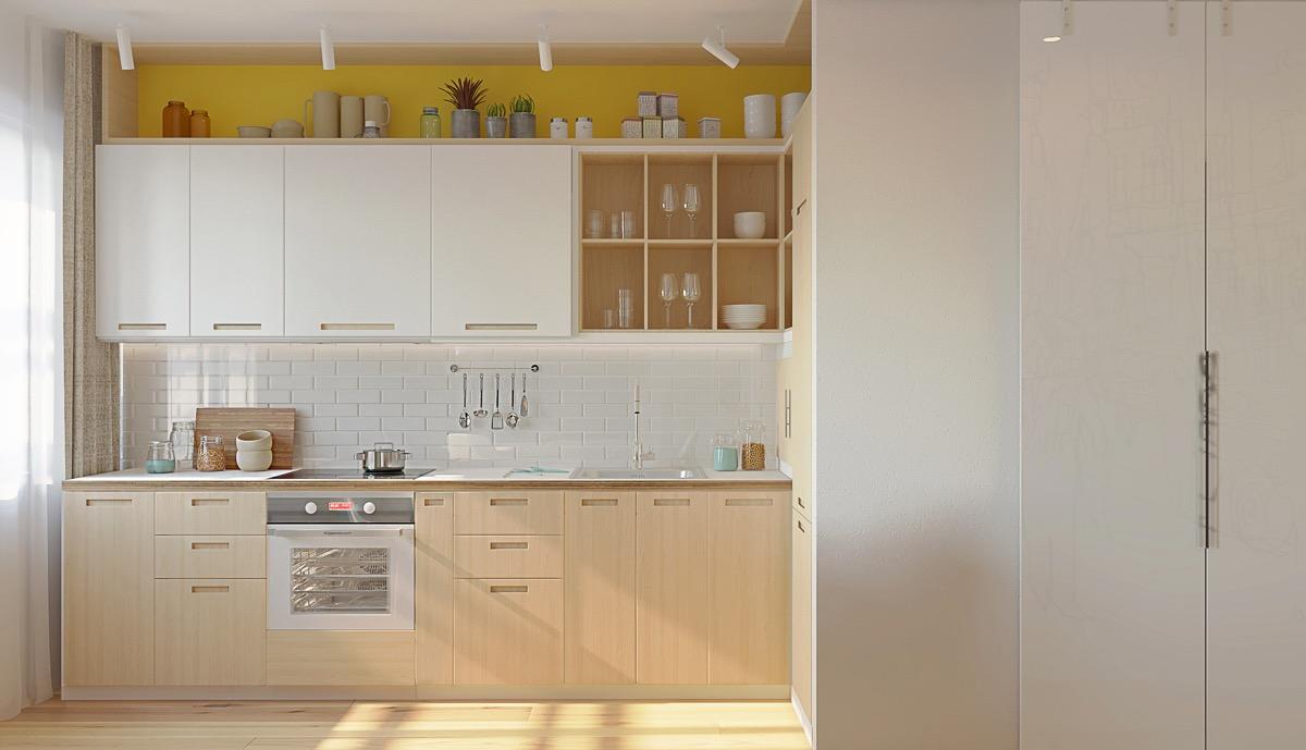 hình ảnh phòng bếp ngập tràn ánh sáng với hộc lưu trữ trên cùng sơn màu vàng mù tạt