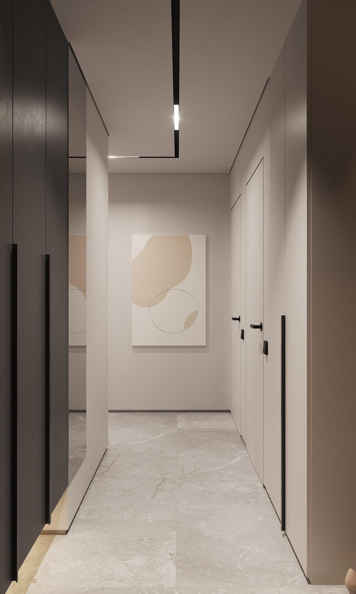 hình ảnh hành lang căn hộ với tranh nghệ thuật treo tường, hệ tủ quần áo cao kịch trần