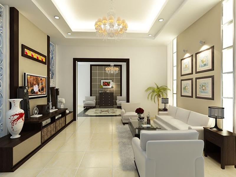 Phòng khách nhà cấp 4 là sự kết hợp giữa phong cách nội thất truyền thống và hiện đại với bộ sofa màu trắng sáng nhẹ nhàng, tương phản với tủ kệ tivi bằng gỗ sẫm màu.