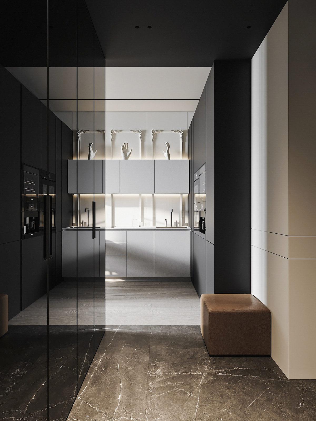 Một loạt các tác phẩm điêu khắc đặt trên đỉnh của tủ bếp, mỗi cái được đóng khung bởi khung viền trang trí đậm chất tân cổ điển.