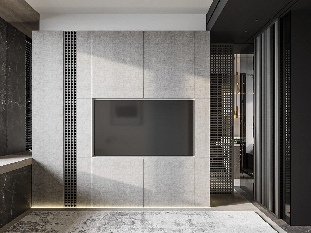 Mảng tường gắn tivi trong phòng ngủ được tích hợp đèn LED ở chân tường, bổ sung ánh sáng cho không gian chức năng này khi đêm xuống.