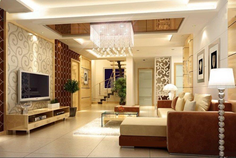 Phòng khách nhà ống được bài trí gọn gàng, thoáng đẹp với bộ ghế sofa màu nâu - trắng ngà kết hợp hài hòa. Đèn chùm lớn tạo điểm nhấn sang trọng.