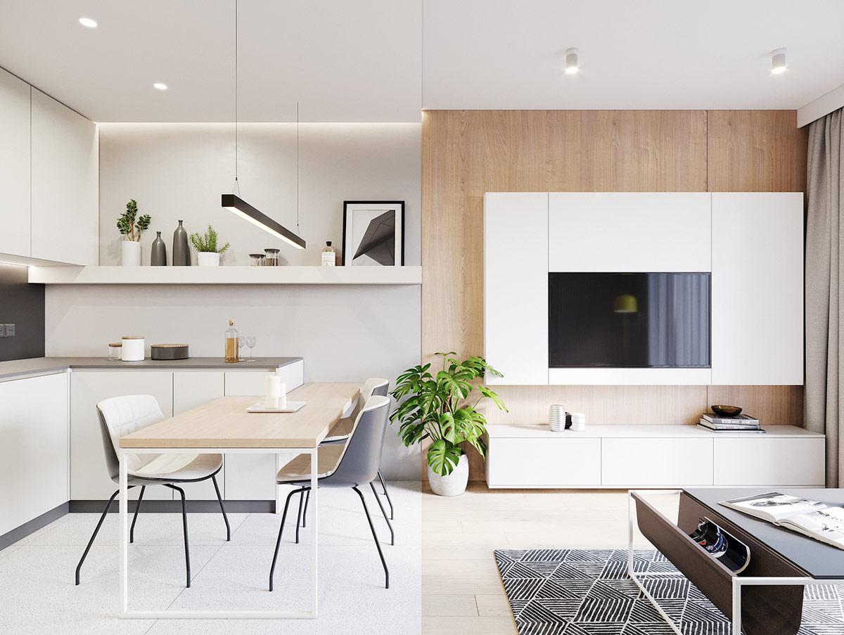 Phòng bếp mở liên thông với phòng khách. Một chiếc bàn ăn nhỏ gọn được thiết kế bao quanh bàn bếp, tạo thành thế chữ U linh hoạt, giúp tận dụng triệt để không gian.