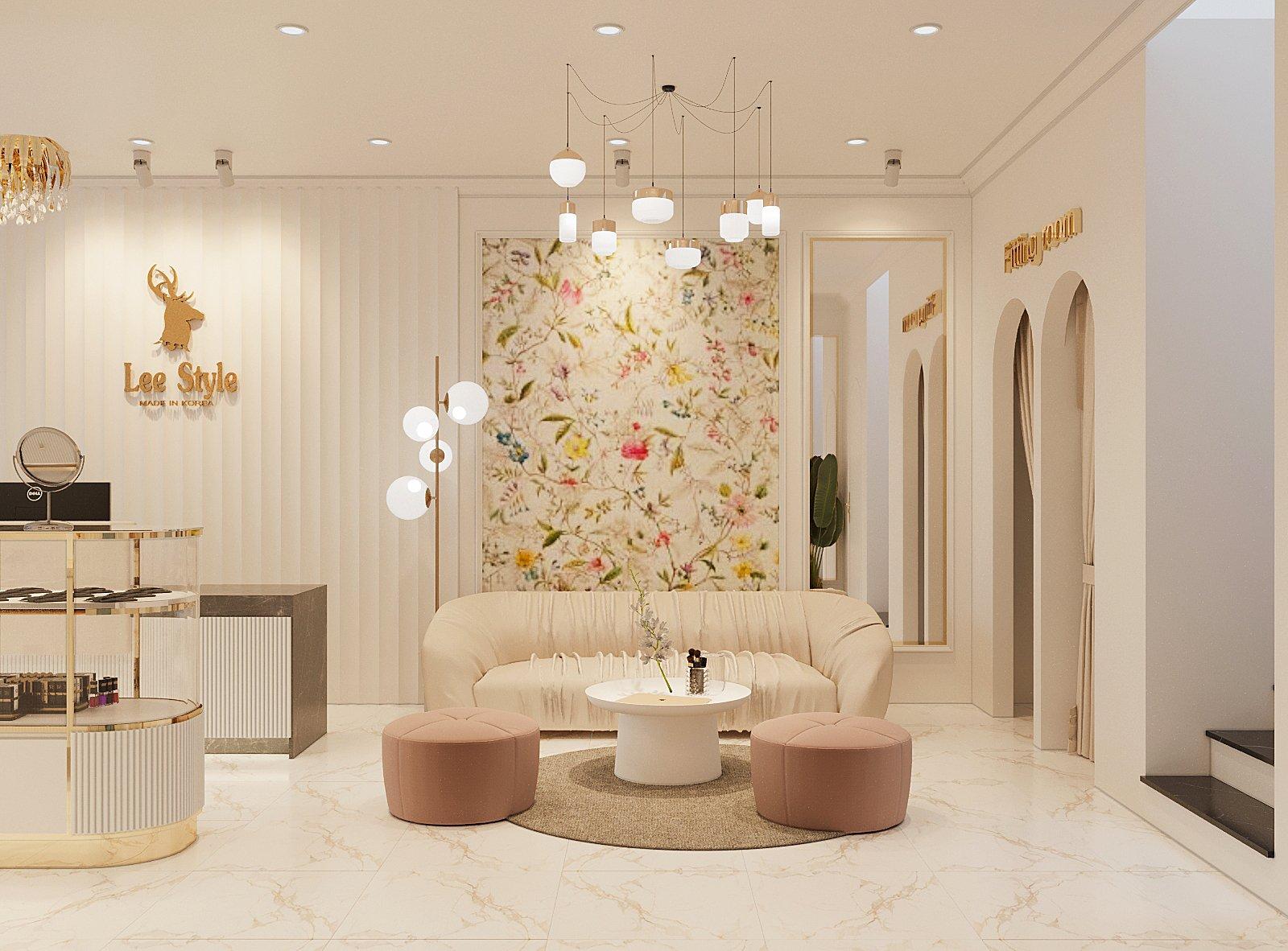hình ảnh phòng khách với ghế sofa màu be bo tròn mềm mại, hai đôn ngồi màu hồng pastel, tranh tường họa tiết hao lá, chim muông