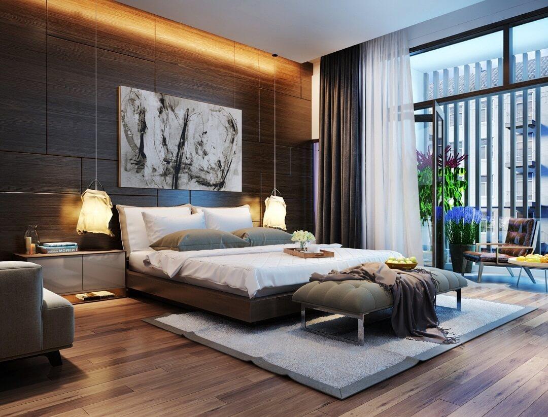 Tông màu gỗ nâu trầm chủ đạo giúp tăng chiều sâu cho không gian phòng ngủ master, đồng thời là phông nền lý tưởng để nội thất màu sáng thêm phần nổi bật.