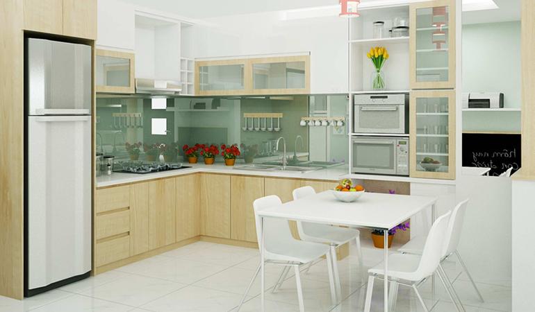 Phòng bếp kết hợp phòng ăn khá rộng rãi, bài trí gọn gàng, đẹp mắt. Bộ bàn ăn màu trắng tinh khôi dành cho gia đình nhỏ trở thành điểm nhấn cực hút mắt.