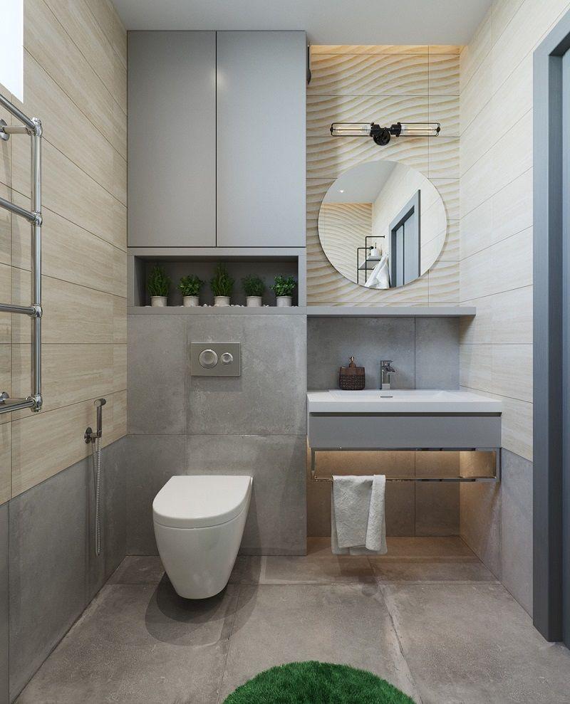 Phòng tắm - vệ sinh tông màu xám bê tông mộc mạc trong nhà ống 2 tầng. Gương tròn tô điểm nét mềm mại tinh tế cho căn phòng.