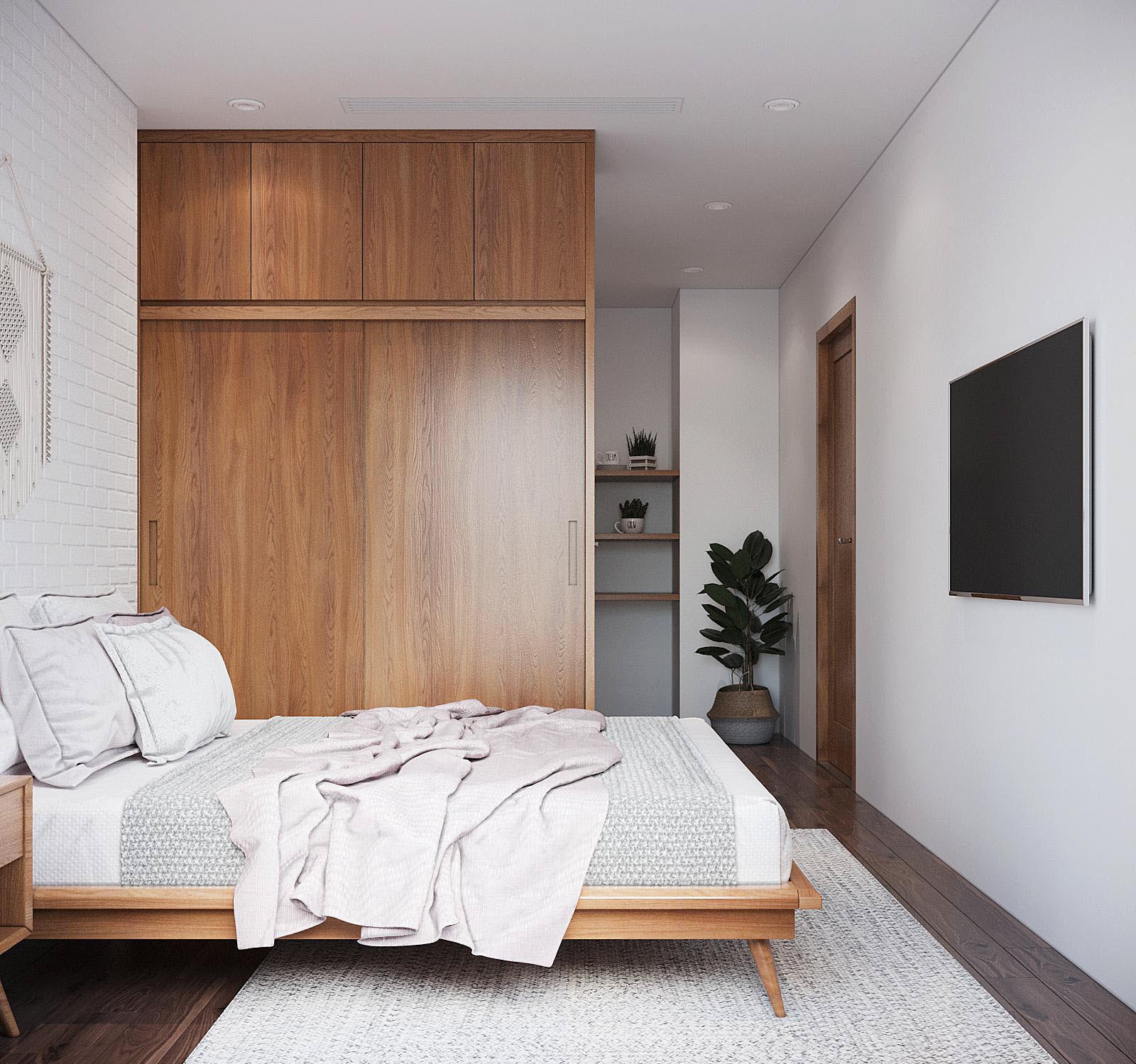 Tủ gỗ cao kịch trần cung cấp không gian lưu trữ thoải mái, đồng thời tạo điểm nhấn ấm áp, giúp cân bằng bảng màu cho căn phòng.