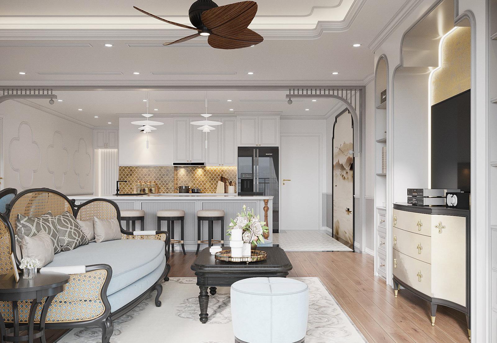 Đối diện khu vực tiếp khách là không gian quầy bar và bếp tiện nghi, sang trọng. Sắc trắng chủ đạo làm phông nền cho nội thất nâu gỗ, đen cá tính thêm phần nổi bật.