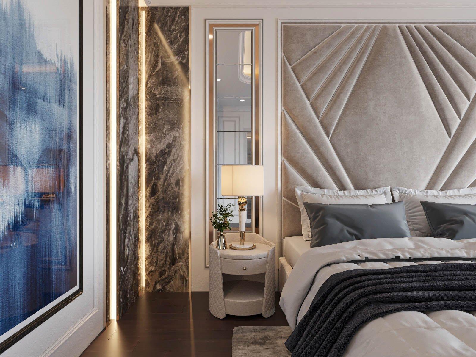 Phòng ngủ được trang bị đầy đủ tiện ích hiện đại với gương chữ nhật dài gắn dọc tường, đèn bàn, tủ ngăn kéo bo tròn mềm mại bài trí đối xứng hai bên.