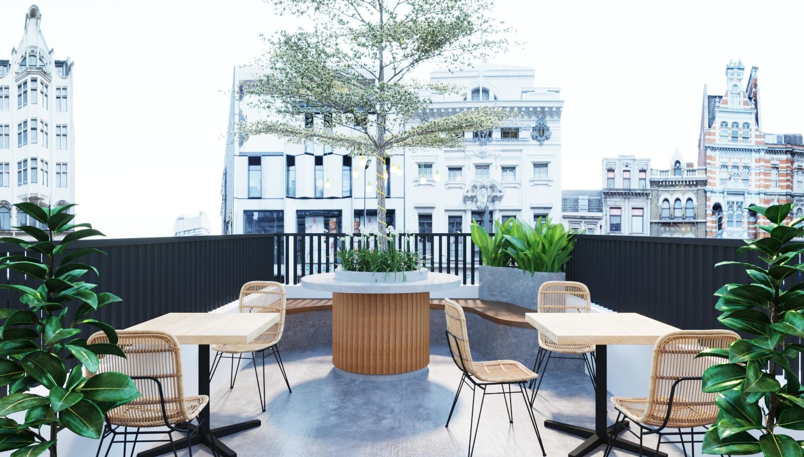 Không gian thưởng thức cà phê ngoài trời thoáng đãng, với tầm nhìn rộng mở.