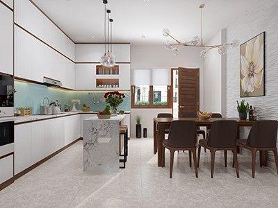 Phòng ăn và bếp nấu được tách biệt tương đối bởi bàn đảo tích hợp quầy bar mini. Tủ bếp cao kịch trần cung cấp không gian lưu trữ thoải mái.