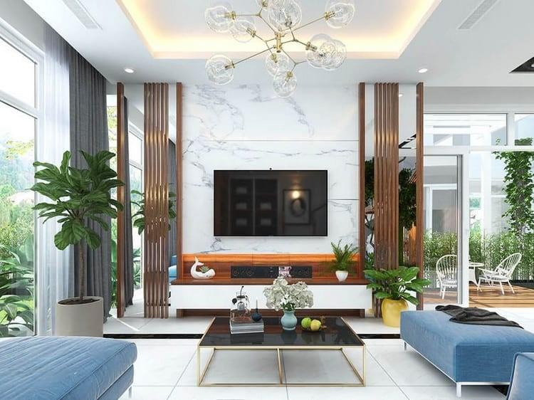 Không gian phòng khách sang trọng, rộng rãi, trần cao thoáng, trang trí tinh tế với đèn chùm kết hợp đèn LED lắp âm.