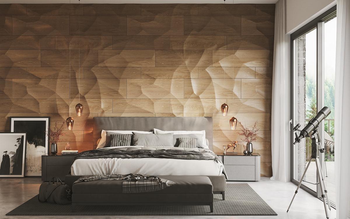 Bức tường đầu giường ốp gỗ với những đường vân chìm nổi vừa là điểm nhấn ấn tượng, vừa giúp gia tăng cảm giác thân thiện, gần gũi trong phòng ngủ.