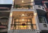 Bán gấp nhà mặt tiền đường Lưu Nhân Chú, P. 5, Tân Bình. DT 4.65x10.5m, trệt 5 lầu nở hậu