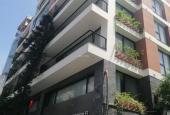 Tòa nhà văn phòng phố Thái Hà mới đét, lô góc 2 thoáng, vỉa hè rộng, 135m2 10 tầng Mt 8m