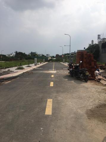 Bán nhanh lô đất ngay chợ Cầu Nguyễn Văn Quá đường 12m sổ hồng riêng giá 2,7 tỷ. LH: 0933.732.939 12989089