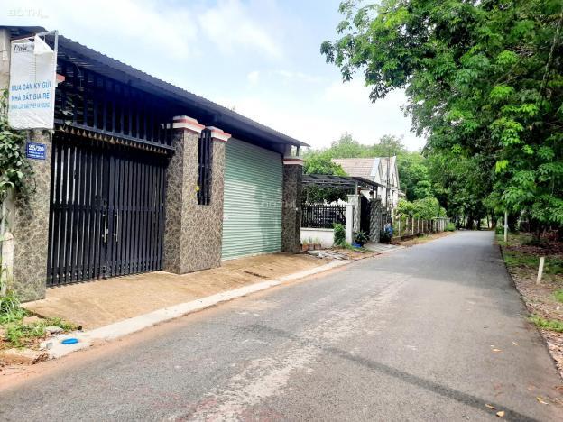 Bán đất mặt tiền DX 064 Định Hòa đường nhựa 5 mét thông qua tái định cư cách đường QL 14 13491124